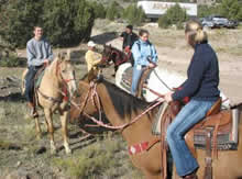 Students participating in a trail ride.